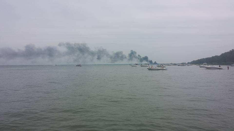 boat fire at pottahawk, smoke in sky
